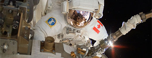 The Canadian Astronaut Dave Williams performs a spacewalk