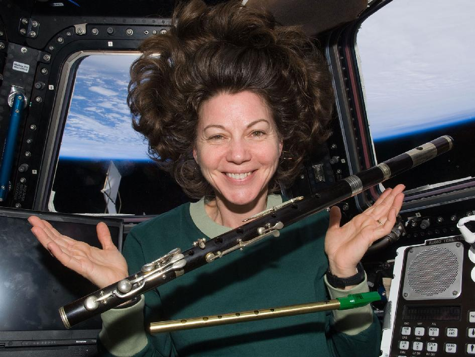 Astronaut Catherine Coleman with flutes in space