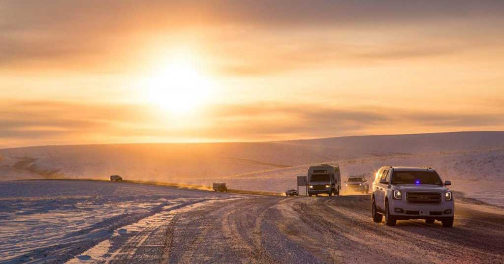 Cars travel on the Inuvik-Tuktoyaktuk highway