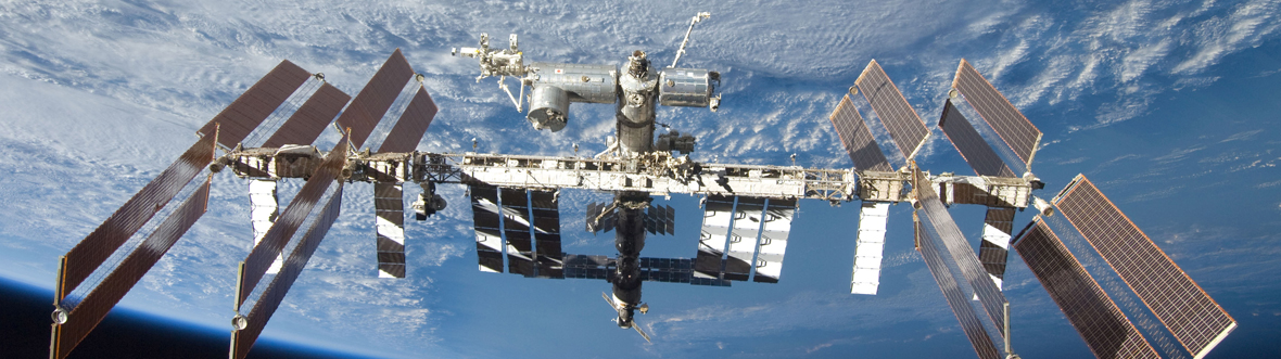 The International Space Station (ISS) from the vantage point of a Space Shuttle Discovery observer.