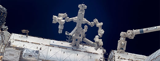 Dextre, with arms open, anchored to the American laboratory, Destiny, on the International Space Station