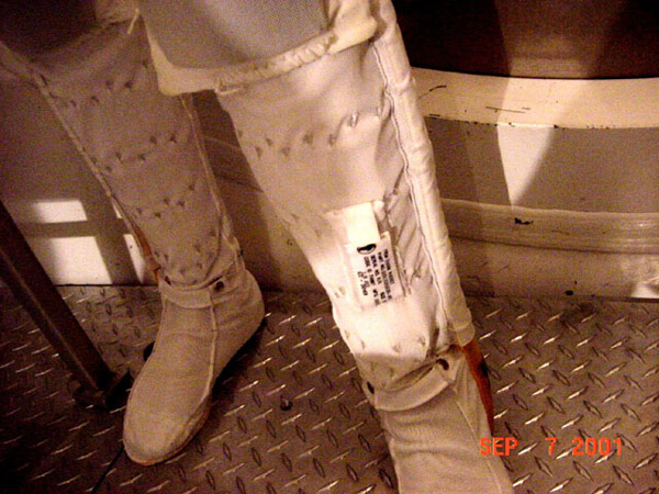 A badge was placed on the lower left leg in a pocket of the astronaut's liquid cooling garment. Two other badges were placed on the head and near the blood forming organs