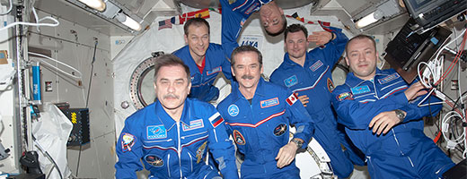 The Expedition 35 crew members gather in the Kibo laboratory