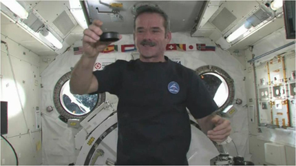 Hadfield drops the puck from the ISS during the Maple Leafs home opener