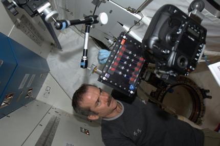 Photo of Chris Hadfield mixing colloids