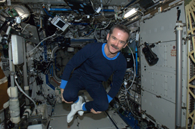 A photo of weightless Chris Hadfield in his new space pajamas