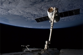 Photo of a Dragon, snared and tamed by Canadarm2