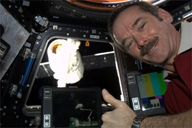 Photo of Chris Hadfield being a happy crewmember