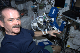 Hadfield, wearing hardware to monitor his blood pressure