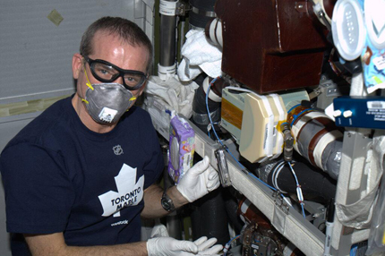 Space Plumber - replacing a low-temp cooling valve in the Columbus Lab.