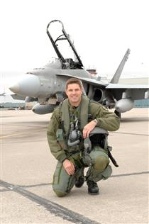 Jeremy Hansen in front of a CF-18