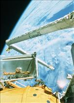 Canadarm installing the Russian Docking Module, STS-74