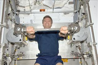 Canadian astronaut Bob Thirsk exercises