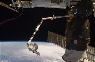 Canadarm2 returns the Exposed Pallet to the HTV