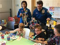 Pediatric cancer patients painting a space suit