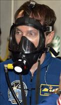 Astronaut Steve MacLean dons the oxygen mask