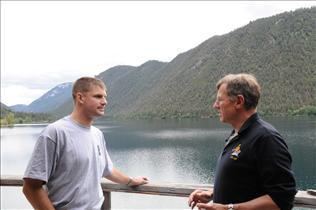 New CSA Astronaut Jeremy Hansen discusses with retired CSA astronaut Dave Williams in Pavillion Lake, BC
