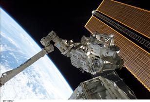 Canadarm2 grapples the Mobile Base System (MBS)