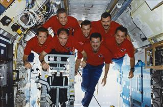 Crew of mission STS-90 in microgravity