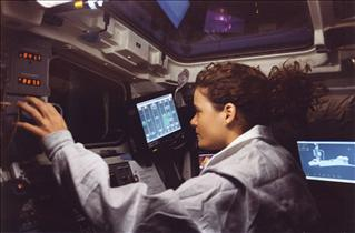 Astronaut Julie Payette and Canadarm