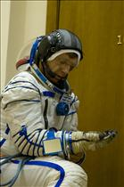 Astronaut Bob Thirsk donning a Russian Sokol