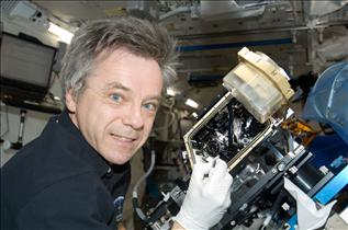 CSA Astronaut Bob Thirsk performs maintenance on the Marangoni Experiment in Space (MEIS)