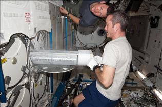 Hadfield stores samples in the ISS Freezer