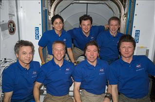 The current Expedition 20 crew get together for a group portrait
