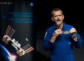 Astronaut Chris Hadfield speaks at a press conference