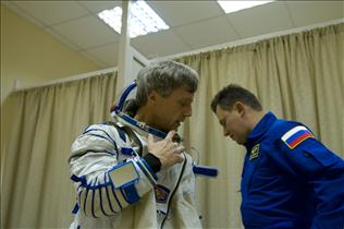 Astronaut Bob Thirsk donning a Russian Sokol suit
