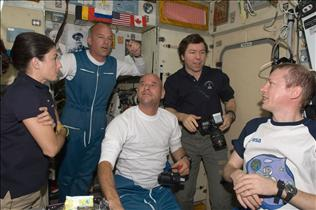 Guy Laliberté and Expedition 21 crewmembers board the International Space Station