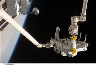 The space shuttle robotic arm, Canadarm...