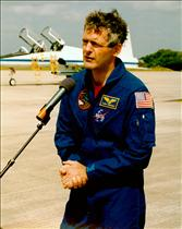 Marc Garneau speaks to the press prior to mission STS-77