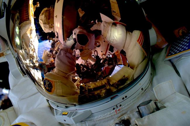 Image of Scott Kelly taking a spacewalk selfie