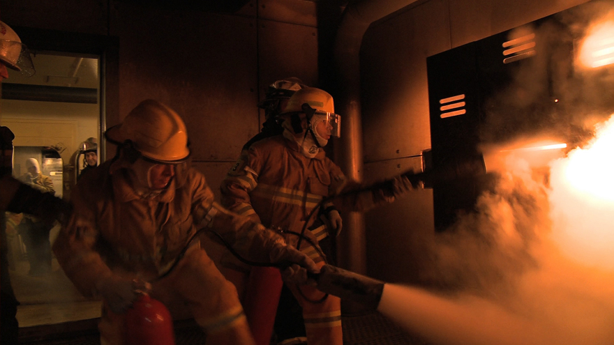 Two astronaut candidates taking part in a fire rescue exercise.