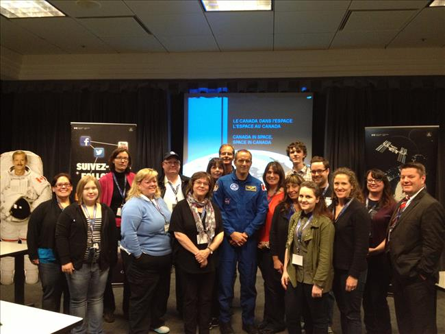 Photo of tweeps and astronaut at the May 2013 tweetup