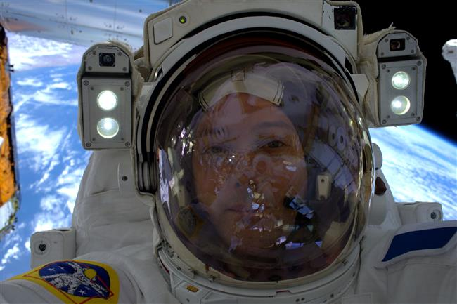 Selfie of Thomas Pesquet during a spacewalk with Earth in the background