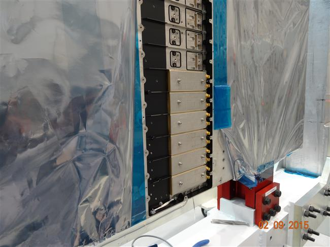 Transmit/receive modules being installed on an RCM SAR panel