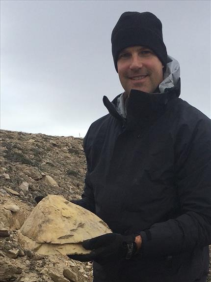 Jeremy Hansen on a geological expedition on Victoria Island - Shatter cone