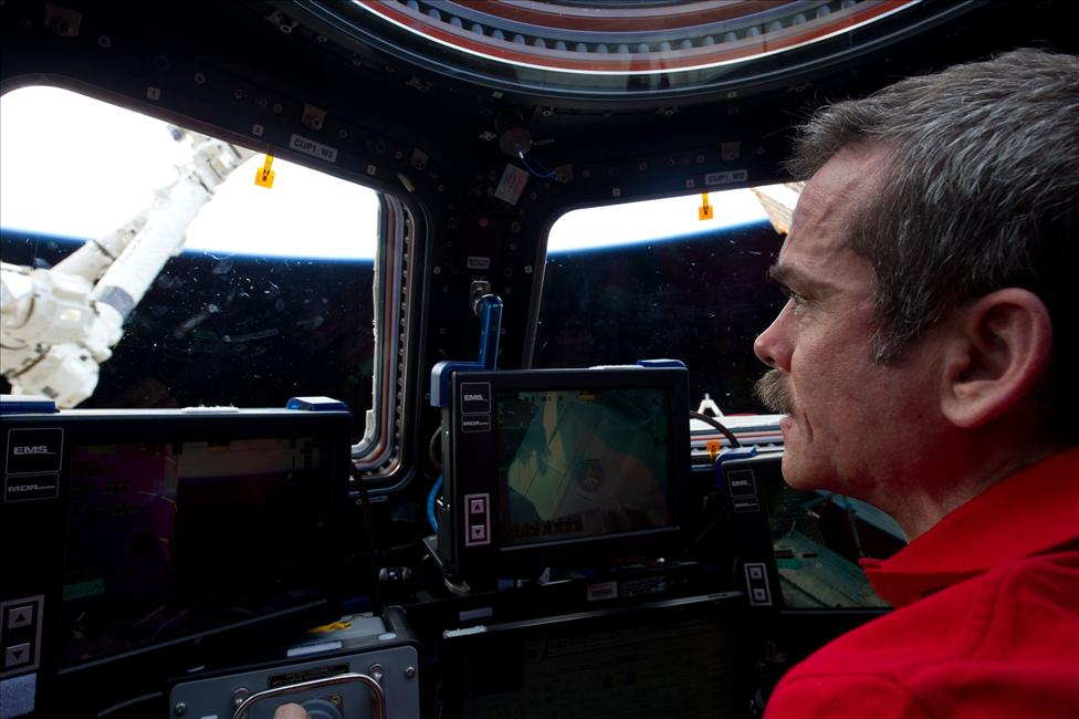 Chris Hadfield at the controls of Canadarm2