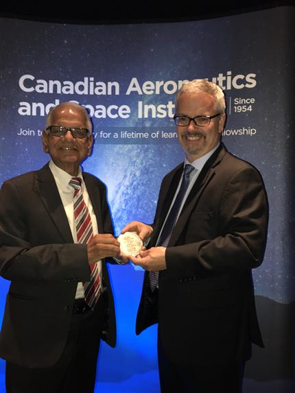 Dr. Virendra Jha presented with the John H. Chapman Award of Excellence