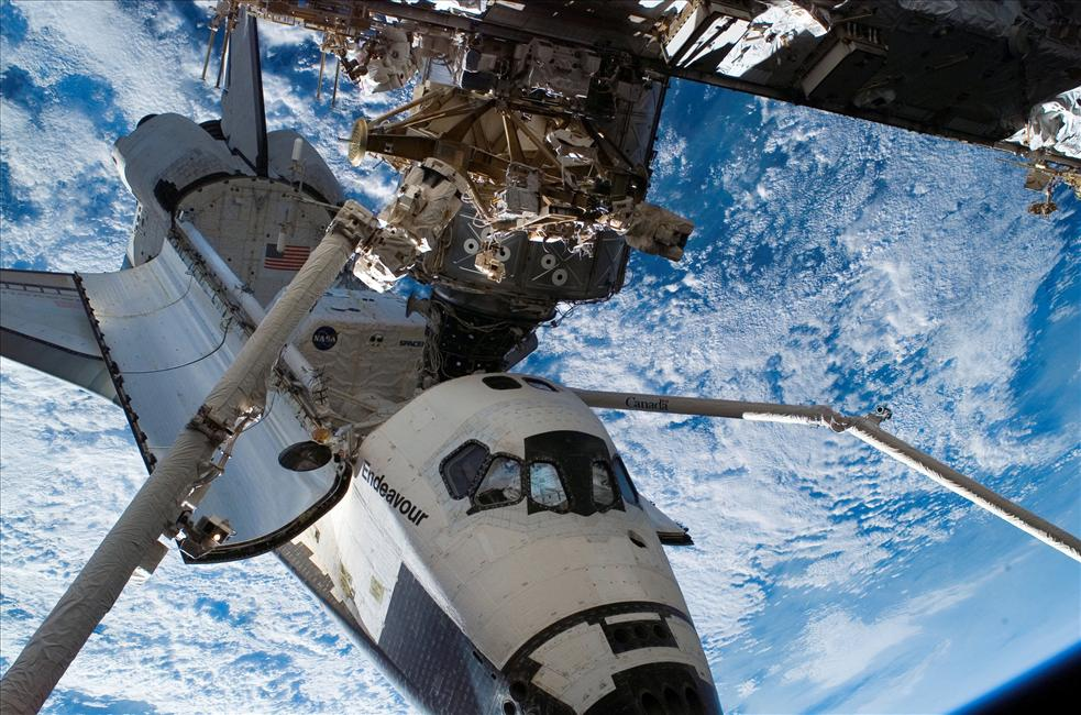 The Canadarm(s) at Work