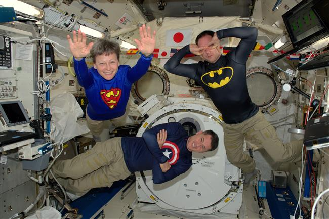 Astronauts dressed as superheroes on the ISS