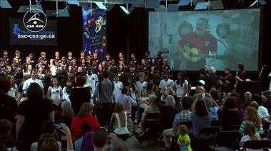 Thumbnail for video 'Chris Hadfield and students from coast-to-coast fill the sky with music (excerpt)'