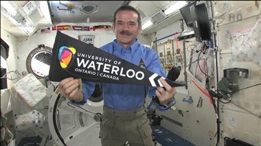 Thumbnail for video 'Chris Hadfield to Speak Live from Space with 500 University of Waterloo Students'